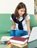 Teenager girl doing homework Royalty Free Stock Photos