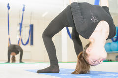 Teenager girl doing stretching and twine, aerial yoga Royalty Free Stock Photo
