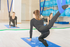 Teenager girl doing stretching and twine, aerial yoga Royalty Free Stock Image