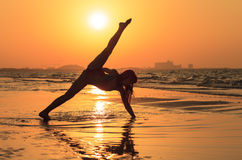 Teenager girl doing yoga at sunset Royalty Free Stock Image