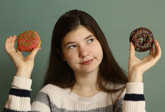 Teenager girl with doughnuts. Close up photo Stock Photography