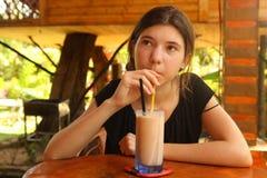 Teenager girl drink sappodila milk shake Stock Photos
