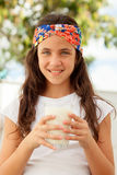 Teenager girl drinking milk glass Stock Image