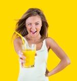 Teenager girl drinking orange juice Stock Image