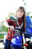 Teenager girl drive blue motorcycle Stock Photo