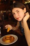 Teenager girl eat roasted bananas Stock Images
