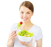Teenager girl eating salad isolated on white Royalty Free Stock Image