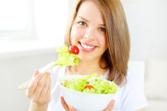 Teenager girl eating salad Stock Image