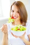 Teenager girl eating salad Stock Photos