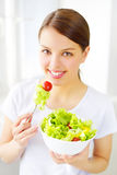 Teenager girl eating salad Royalty Free Stock Image