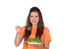 Teenager girl eating vegetables Stock Photo