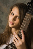 Teenager girl with electric guitar Stock Photos