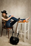 Teenager girl with electric guitar Stock Image