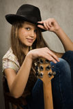 Teenager girl with electric guitar. Portrait of the teenager girl with electric guitar Stock Photo