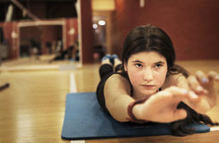 Teenager girl exercising in gym back muscles Royalty Free Stock Image