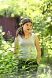 Teenager girl farmer gardening in farm yard on seed bed royalty free stock photography