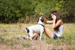 Teenager girl feeding her doggy Royalty Free Stock Image