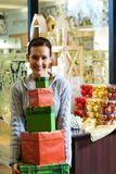 Teenager girl with gift boxes. In a shop Stock Image