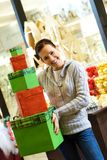 Teenager girl with gift boxes. In a shop Royalty Free Stock Images