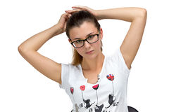 Teenager girl with glasses fixing her hair Stock Photography