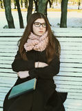Teenager girl in glasses with long brown hair and book Royalty Free Stock Image