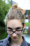 Teenager girl with glasses Stock Photos