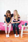 Teenager girl with grief sitting on bed Royalty Free Stock Image