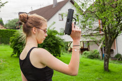 Teenager girl with gun Stock Photos