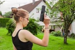 Teenager girl with gun Stock Photos