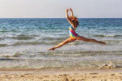 Teenager girl during gymnastic workout on the beach. In the afternoon Royalty Free Stock Photo