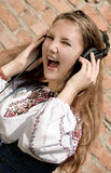 Teenager girl in headphones Royalty Free Stock Photo