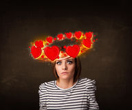 Teenager girl with heart illustrations circleing around her head Royalty Free Stock Image