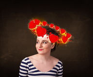 Teenager girl with heart illustrations circleing around her head Royalty Free Stock Photography