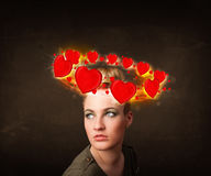 Teenager girl with heart illustrations circleing around her head Royalty Free Stock Photos