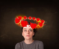 Teenager girl with heart illustrations circleing around her head Stock Photos