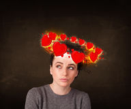 Teenager girl with heart illustrations circleing around her head Royalty Free Stock Images