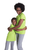 A teenager girl and her younger sister. Isolated on white Stock Photos