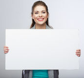Teenager girl hold white blank banner. Royalty Free Stock Photos