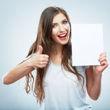 Teenager girl hold white blank paper. Thumb up.Young smiling wo Stock Photos