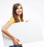 Teenager girl hold white blank paper. Young smiling woman show b Stock Photography