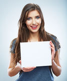 Teenager girl hold white blank paper. Young smilin Royalty Free Stock Image