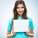 Teenager girl hold white blank paper. Young smiling woman show Stock Image