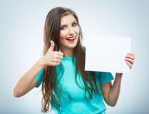 Teenager girl hold white blank paper. Young smiling woman show Stock Photography