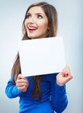 Teenager girl hold white blank paper. Young smiling woman show Royalty Free Stock Photos