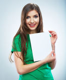 Teenager girl hold white blank paper. Young smilin Stock Photos