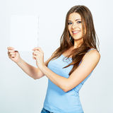 Teenager girl hold white blank paper. Young smiling woman show Royalty Free Stock Image