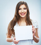Teenager girl hold white blank paper. Young smiling woman show Stock Photo