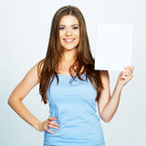 Teenager girl hold white blank paper. Young smiling woman show Royalty Free Stock Photography