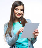 Teenager girl hold white blank paper. Young smilin Stock Image