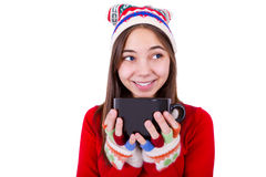 Teenager Girl Holding Coffee Cup. With colorful fingerless gloves Stock Images